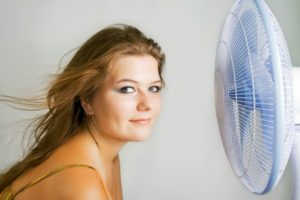 The fan blows to face of woman
